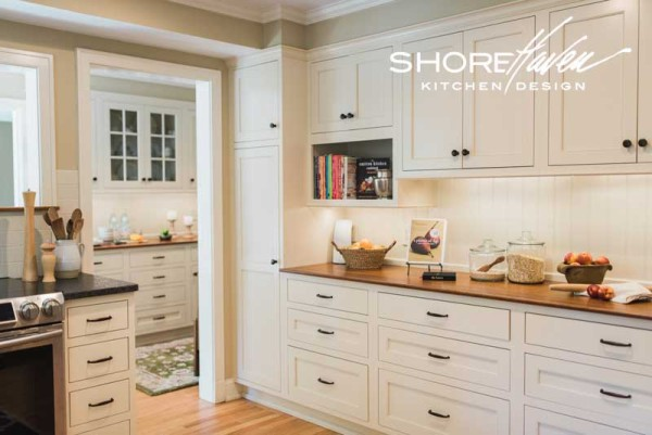 Baker's wall offers plenty of storage for cookbooks, cookware, ingredients, and microwave.