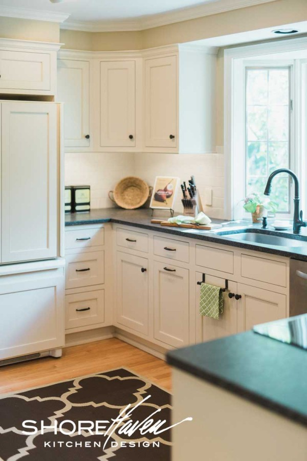 Custom panels allow the existing refrigerator to blend into the surrounding cabinetry.